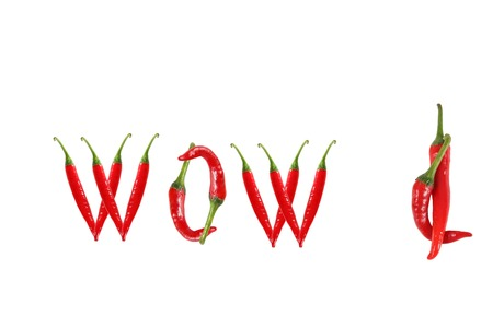 WOW text composed of chili peppers. Isolated on white background photo
