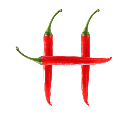 Font made of hot red chili pepper isolated on white - letter H