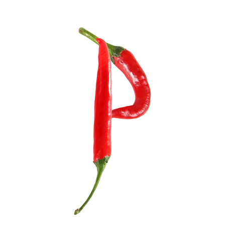alphabetical order: Font made of hot red chili pepper isolated on white - letter P Stock Photo