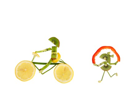 Healthy eating. Funny little people of the kiwi slices. photo
