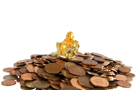 Smiling Golden Buddha Statue on heap of different coins isolated on white  Standard-Bild