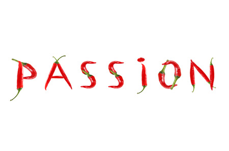 Picture of the word PASSION written with red chili peppers Archivio Fotografico