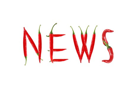 NEWS text composed of chili peppers  Isolated on white background photo