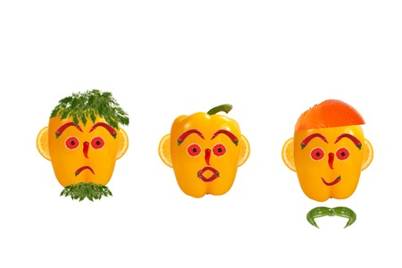 Healthy eating. Funny mens faces made of vegetables and fruits with open-eyed photo