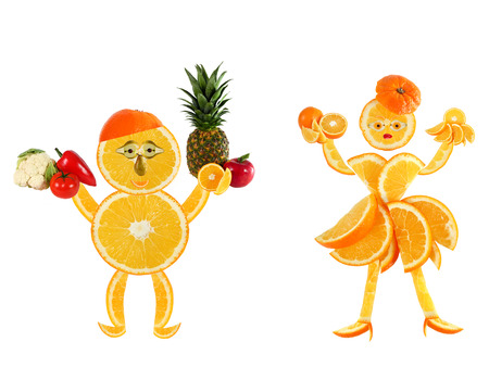 Healthy eating.Two funny little oranges  made of the orange slices. photo