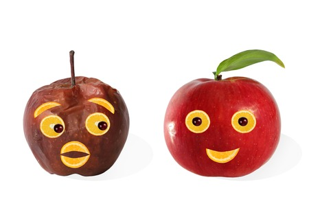 heathy: Creative food  Positive and negative portraits made from apples    Stock Photo
