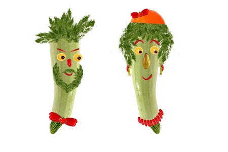 Two funny portrait of men and women, made   from zucchini and fruit photo
