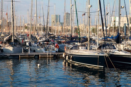 Yachts at the Port of Barcelona Harbor, Spain at the sunset