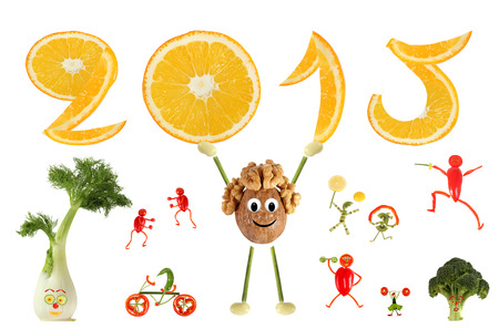 Healthy eating. Funny little man of the walnut raises 2015. Stock Photo