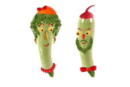 Two funny portrait of men and women, made ??from zucchini and fruit photo