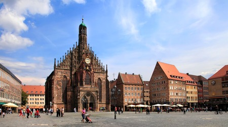 hauptmarkt: NURNBERG, GERMANY - JULY 13 2014: The Frauenkirche (Church of Ladies) in Hauptmarkt, Nuremberg, Bavaria, Germany. Nuremberg accommodates annually more than 2 millions tourists Editorial