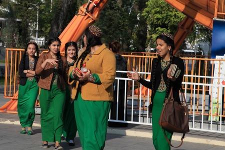skullcap: Ashgabad, Turkmenistan - October 10, 2014. Unidentified schoolgirls  in national dress are having fun at amusement park on  October 10, 2014. Ashgabad, capital of Turkmenistan.