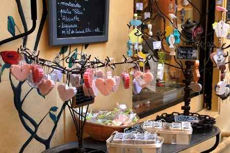 french perfume: GRASSE, FRANCE - JULY 5: Homemade multi colored soap and another cosmetics and gifts in a street  of the city of Grasse  shop in France. Editorial