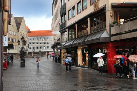 rainy day: NURNBERG, GERMANY - JULY 13 2014: Rainy Day. Hauptmarkt, the central square of Nuremberg, Bavaria, Germany.  Nuremberg accommodates annually more than 2 millions tourists Editorial
