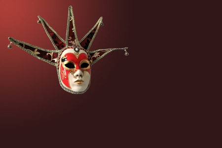 burgundy background: Traditional Venetian mask on burgundy background