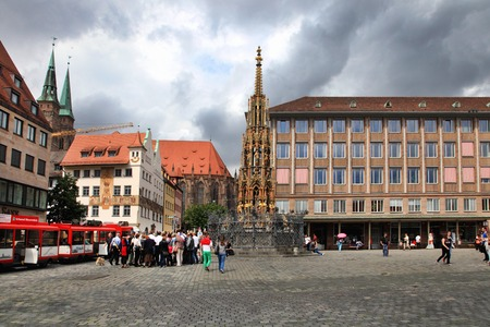 christkindlesmarkt: NURNBERG, GERMANY - JULY 13 2014: Hauptmarkt, the central square of Nuremberg, Bavaria, Germany.  Nuremberg accommodates annually more than 2 millions tourists