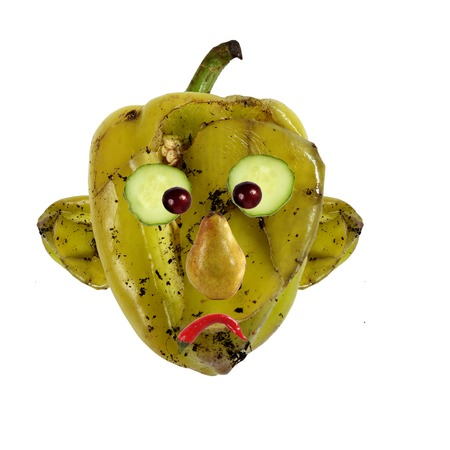 putrid: Creative food concept. Negative portraits made of green spoiled  pepper.