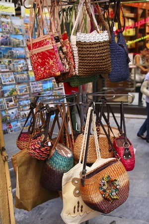 sold small: Handmade women bags sold at the market. Street shopping for handbags