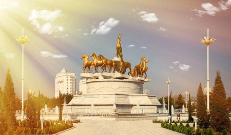 turkmenistan: Sculptural composition to fast horses in the park with retro vintage  style filter effect. Ashkhabad, Turkmenistan.