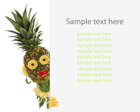 sample text: Creative food concept. Funny little pineapple looks  with sample text.