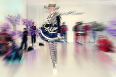 fashion model catwalk: fashion model on catwalk - radial zoom blur effect defocusing filter applied Stock Photo