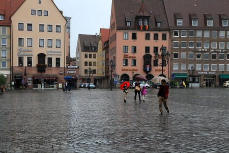 hauptmarkt: NURNBERG, GERMANY - JULY 13 2014: Rainy Day. Hauptmarkt, the central square of Nuremberg, Bavaria, Germany.  Nuremberg accommodates annually more than 2 millions tourists Editorial