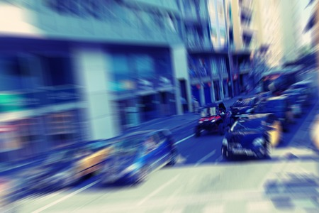 zoom in: Abstract background. Traffic blur motion in modern city  - rush hour in Barcelona, Spain.  Radial zoom blur effect defocusing filter applied Stock Photo
