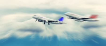 jets: Abstract background. Two passenger jets flying above the clouds. Radial zoom blur effect defocusing filter applied
