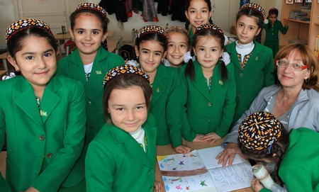 Ashgabad, Turkmenistan - November 4, 2014. Group of students with the teacher in the classroom after school.  November 4, 2014.  In schools of Turkmenistan annually trains about 900 thousand children. Editorial