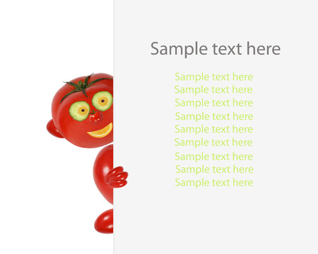 sample text: Creative food concept. Funny little tomato looks  and smile with sample text. Stock Photo
