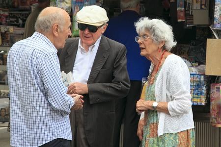 daniele: VENICE, MESTRE-June 29, 2014. Two elderly men and women talking on Piazza Erminio Ferretto in Italy. Mestre is the most populated urban area of the mainland of Venice, part of the territory of the city of Venice, in Veneto, Italy.