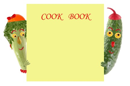 sample text: Creative food concept. Funny little zucchini and cucumber look  and smile with sample text. Stock Photo