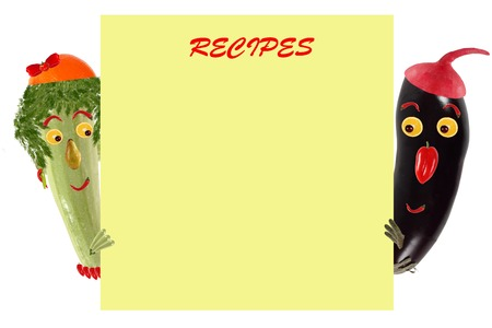 sample text: Creative food concept. Funny little zucchini and eggplant look  and smile with sample text.