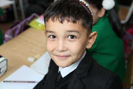 schoolroom: Ashgabad, Turkmenistan - November 4, 2014. Portrait of an unknown  schoolboy in the classroom.  November 4, 2014.  In schools of Turkmenistan annually trains about 900 thousand children.