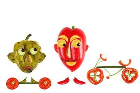 resentment: Creative food concept. Positive and negative funny little peppers want to play sports Stock Photo