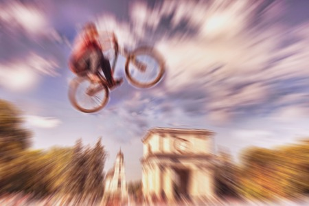 central square: Abstract background . Boy on a BMX mountain bike jumping. Motion blur photo. Competition in Kishinev, Moldova central square.