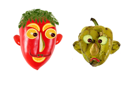 putrid: Creative food concept. Positive and negative portraits made of green and red peppers