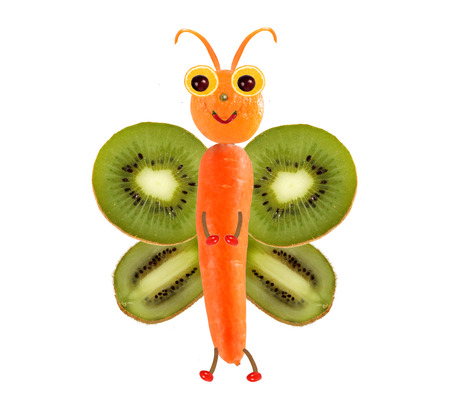 children eating fruit: Creative food concept. Funny little butterfly made of fruits and vegetables.