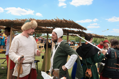involving: Vatra, Moldova. June 28, 2015. Medieval Festival. Historic clubs from Europe - theatrical performances involving the troubadours, knights.