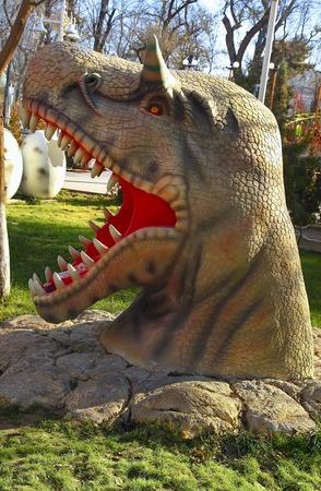 lifelike: Ashgabat, Turkmenistan - December 23, 2014.  Realistic model of head  Dinosaur in the central park Ashgabat. Ashgabat, December 23, 2014. Ashgabat the capital of Turkmenistan.