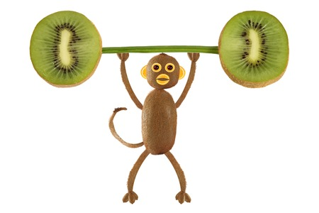 kiwi fruit: Healthy eating. Funny little  monkey made from kiwi raise the bar of kiwi