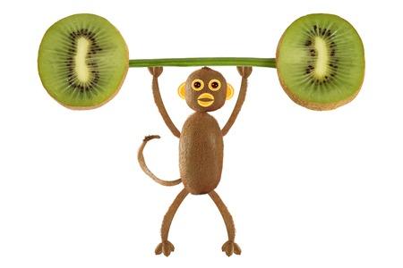 kiwi: Healthy eating. Funny little  monkey made from kiwi raise the bar of kiwi