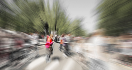 creativ: Abstract background. Pedestrians walking - rush hour i.  Radial zoom blur effect defocusing filter applied, with vintage instagram look.