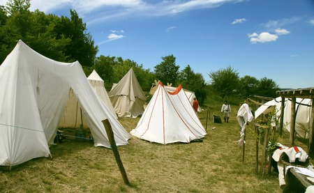 involving: Vatra, Moldova. June 28, 2015. Medieval Festival. Historic clubs from Europe - theatrical performances involving the troubadours, knights. Tent camp. Editoriali