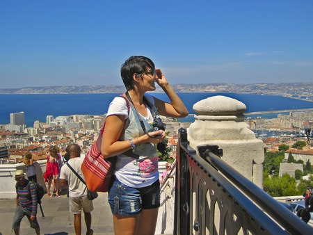 garde: MARSEILLE, FRANCE - AUGUST 16, 2015. Happy tourists visiting Marseille from the observation deck of the cathedral  Notre Dame de la Garde. MARSEILLE, FRANCE - AUGUST 16, 2015.