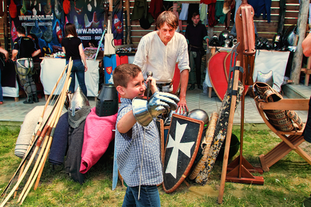involving: Vatra, Moldova. June 28, 2015. Medieval Festival. Spectators are theatrical performances involving the troubadours, knights.