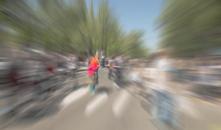 creativ: Abstract background. Pedestrians walking - rush hour i.  Radial zoom blur effect defocusing filter applied