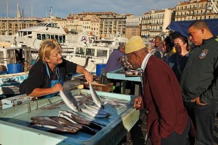 city fish market: FRANCE, MARSEILLE -October 19, 2015: The buyer at the fish market in Marseille.  Old Port of Marseille (Vieux-Port), Marseille is Frances largest city on the Mediterranean coast and largest commercial port. October 19, 2015. Editorial