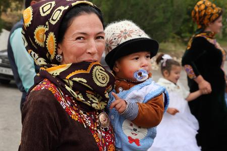 Kov-Ata, Turkmenistan - October 18: Portrait of an unknown Asian woman with baby. Kov-Ata, Turkmenistan - October 18