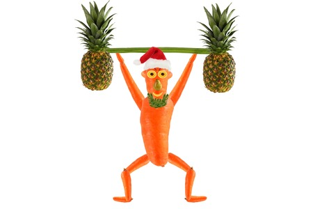 raises: Healthy eating. Funny little man  raises bar.  Happy New Year.